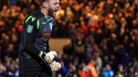 Colchester United keeper Dean Gerken celebrates during the penalty shoot-out victory over Tottenham.
