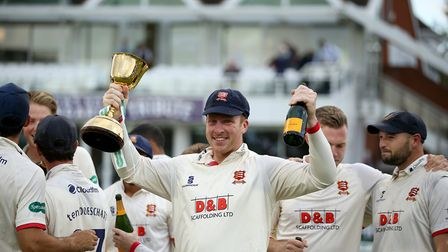 Essex's Simon Harmer celebrates with the trophy after the Specsavers County Championship, Division O