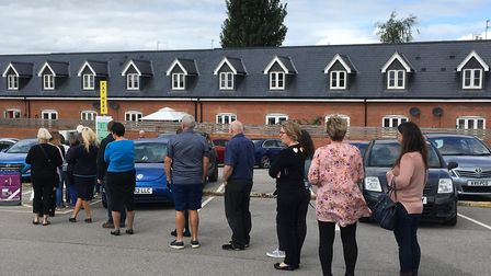 Shoppers queuing at one of the working payment machines in the St Andrews short stay car park in Bur