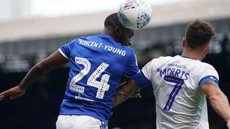 Kane Vincent-Young beats Kieron Morris to head the ball in the first half. Picture: Steve Waller