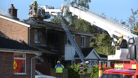 Firefighters at the fatal house fire in Capel St Mary Picture: SARAH LUCY BROWN
