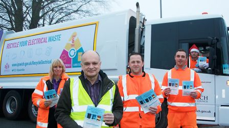 Phil Smart with a team of refuse collectors and the leaflet highlighting the Christmas changes to wa