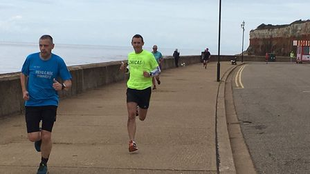 Runners surge to the finish of the first-ever Hunstanrton parkrun, held in warm, dry conditions. Pic