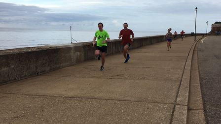 Runners approach the finish, along the promenade. Picture: CARL MARSTON