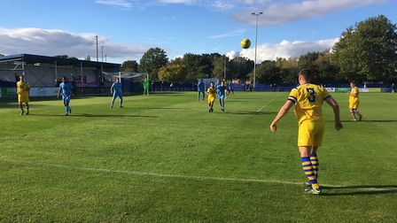 Joe Whight launches a long throw into the danger area, as AFC Sudbury go on the attack at Brentwood.