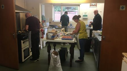 The bakers hard at work in the kitchen creating the scones Picture: PHILIP TALLENT