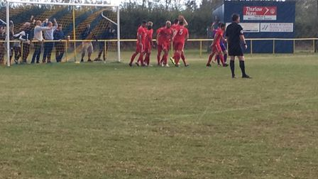 Stowmarket Town celebrate their opening goal, scored by Josh Mayhew during the 3-0 victory at Norwic