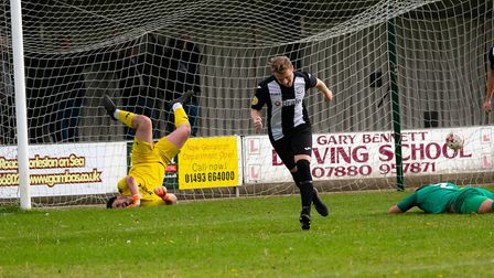 Jake Rudge opens the scoring for Woodbridge Town during their 7-1 win at Gorleston. Picture: PAUL LE