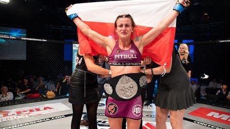 New Contenders strawweight champion Ewelina Wozniak with the belt after her points win over Karolina