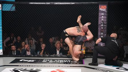 Richard Mearns sinks in the fight-ending armbar on Scott Butters at Contenders 27. Picture: BRETT KI