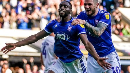 A happy place. Kane Vincent-Young celebrates with James Norwood after scoring to give Town their fou