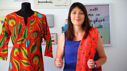 Ipswich businesswoman Jo Salter with one of the new African tunic dresses, made in Malawi for her Wh