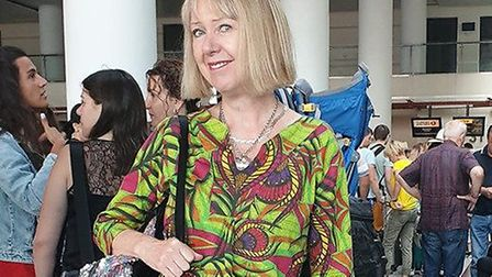 Elene Marsden from Ipswich wearing her African tunic dress, green peacock feather design, made in Af