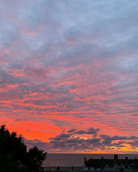 Photos of the sunrise taken over the high street in Aldeburgh. Picture: LOUISE SANT