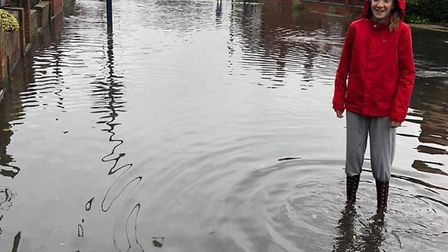 Amie Laws, 12, standing in floodwater in High Road West, Felixstowe which was closed because of the