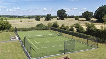 Hill Farm House even has a tennis court in its grounds. Picture: BEDFORDS