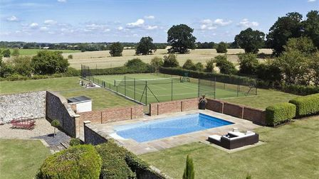 Hill Farm House even has a tennis court in its grounds along with a pool. Picture: BEDFORDS