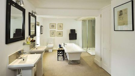 Hill Farm House has a luxury bathroom with a free-standing bath. Picture: BEDFORDS