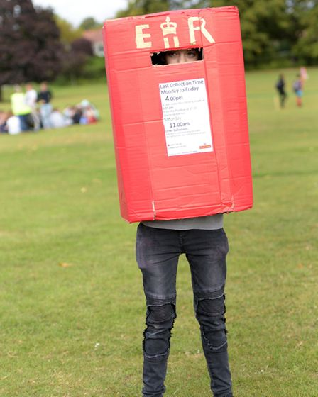 A pupil dressed as a post box Picture: SARAH LUCY BROWN