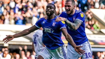 Kane Vincent-Young celebrates with James Norwood after scoring to give Town their fourth in the 4-1