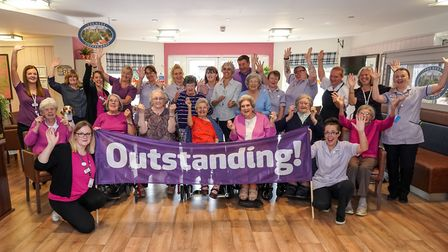 Mills Meadow Care Home staff and residents celebrate their home being rated as 'Outstanding' by the