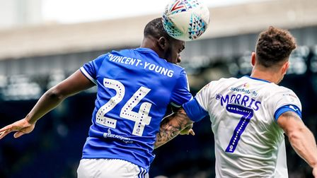 Kane Vincent-Young beats Kieron Morris in the air against Tranmere. Photo: Steve Waller