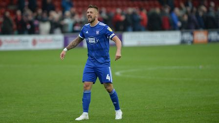 Luke Chambers celebrates with the fans at Fleetwood Picture Pagepix