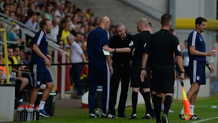 Ipswich Town coach Matt Gill (left) is sent to the stands at Burton Albion. Photo: Pagepix