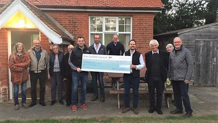 Cllr Mallinder with Boyton Parish Council and residents receiving their cheque for repair funds. Pic