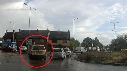 Watch the reckless driver illegally overtake the standstill traffic on the roundabout. Picture: CHAR