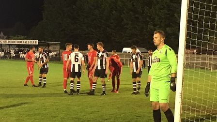 Long Melford prepare to defend another Stowmarket corner, with home keeper Matt Walker patrolling hi