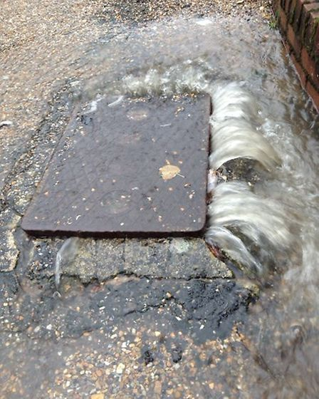 A sewer cover bursts open due to excessive flooding Picture: SAFE