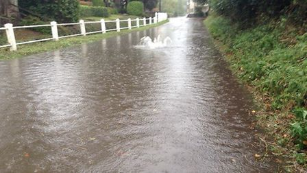 A flooded road in Fressingfield, with a sewage cover bursting open Picture: SAFE