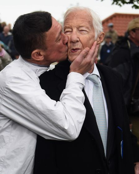 Lester Piggott gets a kiss from Frankie Dettori at the unveiling of Lester's bronze sculpture in the