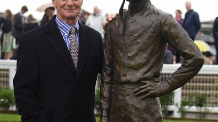 William Newton with his bronze sculpture of Lester Piggott in the parade ring at the Rowley Mile Rac
