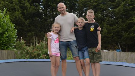 John Clarke enjoying time with his children, William, Finley and Caitlin. He is signed off sick afte
