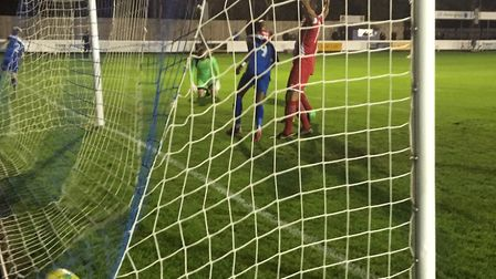 The ball is nestling in the bottom corner of the net and Ryan Stafford, left, has already turned awa