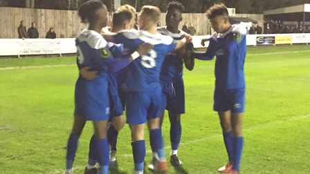 It's celebration time after Cemal Ramadan's lethal finish put Bury Town 2-0 up against Felixstowe &