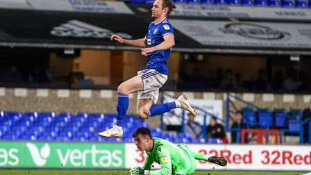 Will Keane leaps over Gillingham keeper Joe Walsh after scoring Town's final goal in their 4-0 EFL T