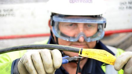 Openreach Engineer laying fibre in a duct as part of �2.5bn super-fast broadband programme.. Photo: