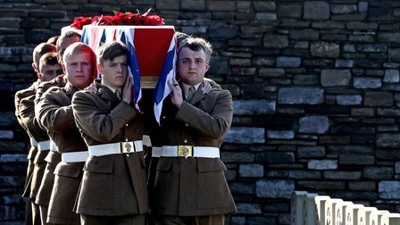 Soldiers from the Royal Fusiliers bear the coffins at the Commonwealth War Graves Commission's Wytsc