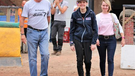 Sam Norris walks out on the track at Mildenhall Fen Tigers with dad Chris, left and mum Claire. Pict