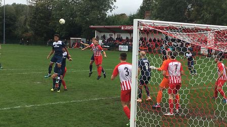 Hadleigh United's Kyron Andrews jump high to head on from a corner. Picture: CARL MARSTON