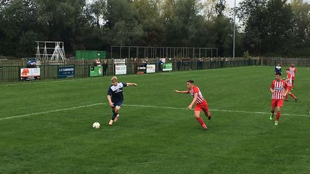 Hadleigh winger, Kyle Cassell, is on the attack against Leighton Town. He scored the first goal of t