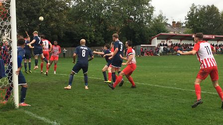 Leighton Town (red and white) finished the first half strongly. Here they are on the attack from a c