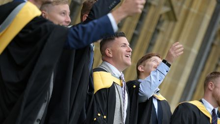 Students from the University of Suffolk at West Suffolk College celebrate their graduation day Pict