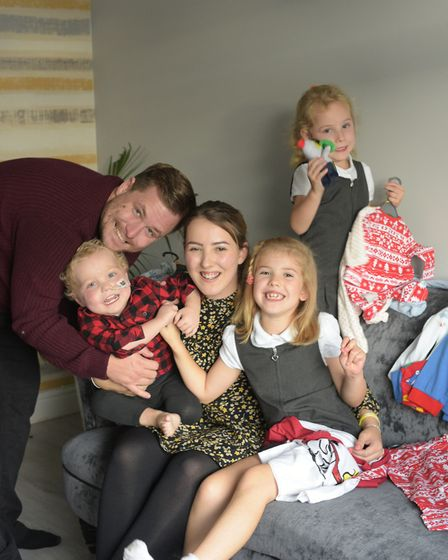 Daniel, Carter, Hannah, Trinity and Scarlett with some of the pyjamas they have collected Picture: