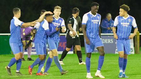 Leiston players celebrate one of the two goals scored by Rhys Henry, second left, in their 3-1 win a