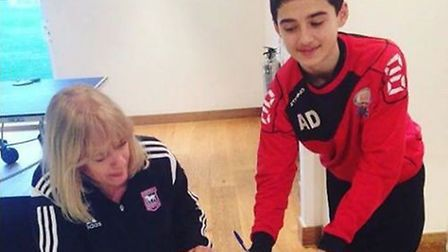 Armando Dobra, pictured signing his scholarship forms with Ipswich Town as a 15-year-old. Picture: F