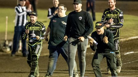 Danny King and Jake Allen join mechanics to celebrate Richard Lawson and James Sarjeant's 4-2 in hea